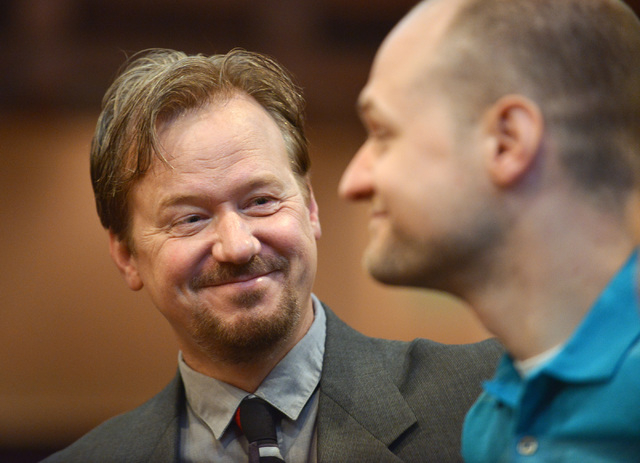 In this June 14, 2014 photo, Frank Schaefer, left, and his son Tim Schaefer speak before a ceremony where Frank Schaefer received an award for his public advocacy marking 10 years of legal gay mar ...
