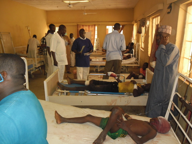 Victims of a suicide bomb explosion at a World Cup viewing center receive treatment at Sani Abacha specialist hospital  in Damaturu, Nigeria,  Wednesday, June 18, 2014. An explosion at an illegal  ...
