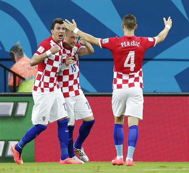 Croatia's Ivica Olic (18) celebrates with his teammates after scoring his side's first goal during the group A World Cup soccer match between Cameroon and Croatia at the Arena da Amazonia in Manau ...
