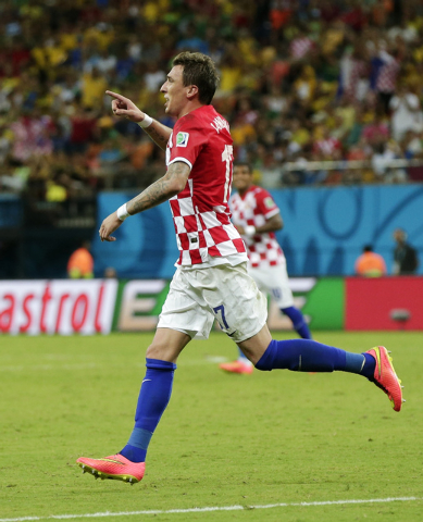 Croatia's Mario Mandzukic celebrates after scoring his side's third goal during the group A World Cup soccer match between Cameroon and Croatia at the Arena da Amazonia in Manaus, Brazil, Wednesda ...