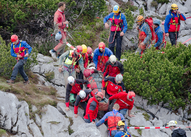 Mountain rescuers carry cave researcher Johann Westhauser, center, out of the Riesending cave near Marktschellenberg, southern Germany, Thursday, June 19, 2014. The German cave researcher has been ...