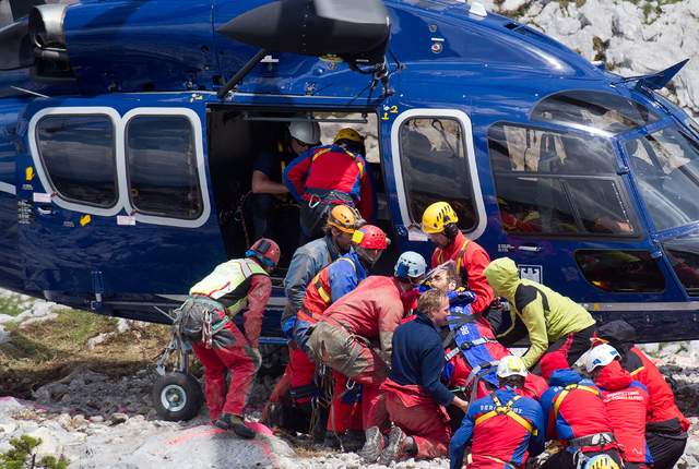 Mountain rescuers carry cave researcher Johann Westhauser, center, to a helicopter outside the Riesending cave in southern Germany, Thursday, June 19, 2014. The German cave researcher was brought  ...
