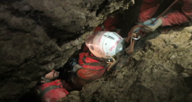This screenshot from a video provided by the Bavarian Mountain Rescue Service on Tuesday, June 17, 2014 shows rescuers transporting cave explorer Johann Westhauser in the Riesending cave near Berc ...