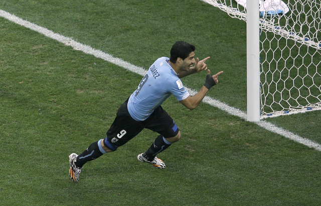 Uruguay's Luis Suarez celebrates scoring the opening goal during the group D World Cup soccer match between Uruguay and England at the Itaquerao Stadium in Sao Paulo, Brazil, Thursday, June 19, 20 ...