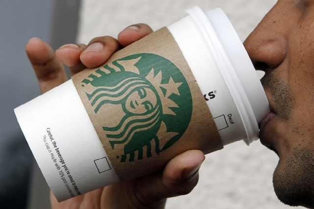 It turns out Starbucks isn't contributing any upfront scholarship money to an online college degree program it introduced on Monday, June 16, 2014. (AP Photo/Alan Diaz)