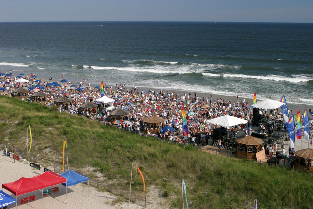 This undated image provided by the Atlantic City Convention & Visitors Authority shows a crowd of spectators on the beach during a concert. Free concerts on the sand abound at the Jersey shore thi ...
