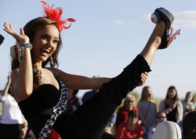 This 2013 file photo shows Miss Alabama Chandler Champion showing her shoe during the Miss America Shoe Parade at the Atlantic City boardwalk in Atlantic City, N.J. The world-famous pageant that b ...