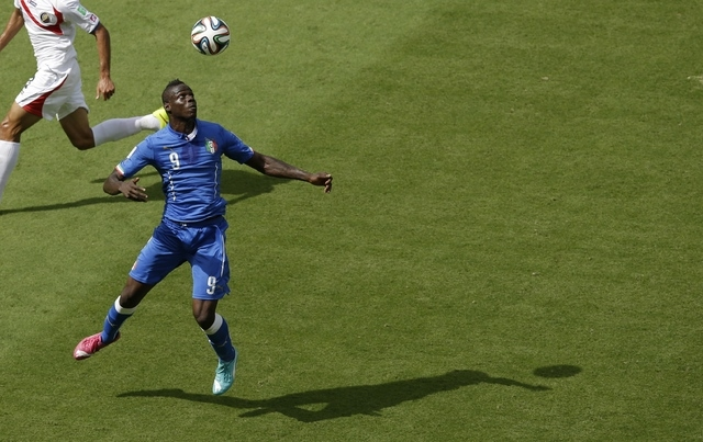 Italy's Mario Balotelli controls the ball during the group D World Cup soccer match between Italy and Costa Rica at the Arena Pernambuco in Recife, Brazil, Friday, June 20, 2014.  (AP Photo/Hassan ...