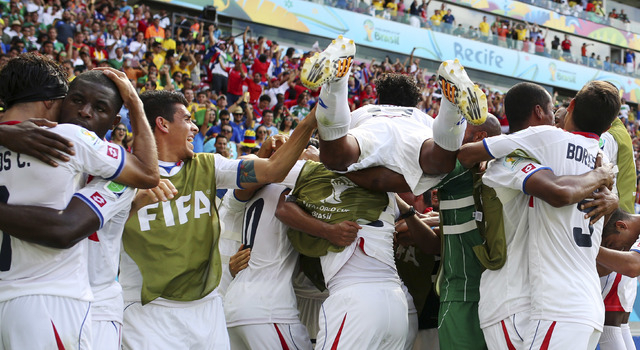 Costa Rican players celebrate after Bryan Ruiz scored his side's first goal during the group D World Cup soccer match between Italy and Costa Rica at the Arena Pernambuco in Recife, Brazil, Friday ...