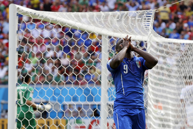 Italy's Mario Balotelli reacts after missing a chance during the group D World Cup soccer match between Italy and Costa Rica at the Arena Pernambuco in Recife, Brazil, Friday, June 20, 2014.  (AP  ...