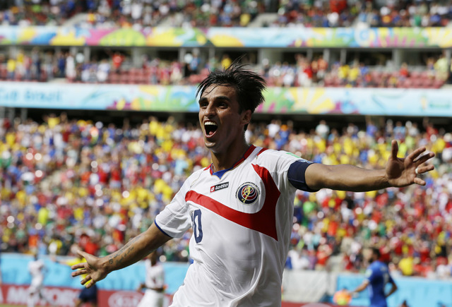 Costa Rica's Bryan Ruiz celebrates after scoring his side's first goal over Italy's goalkeeper Gianluigi Buffon during the group D World Cup soccer match between Italy and Costa Rica at the Arena  ...