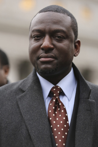 In this Jan. 17, 2013 file photo, Yusef Salaam is photographed during a rally outside Federal court in New York.  A city official said Friday, June 20, 2014 that New York City has agreed to a $40  ...