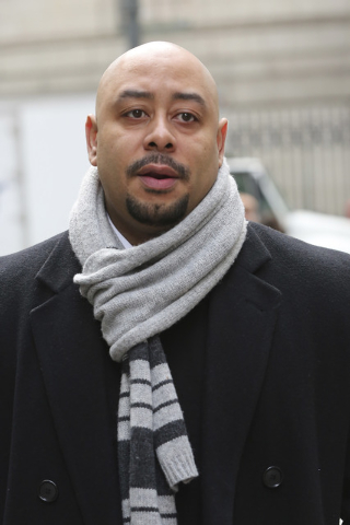 In this Jan. 17, 2013 file photo, Raymond Santana is photographed during a rally outside Federal court in New York. A city official said Friday, June 20, 2014 that New York City has agreed to a $4 ...