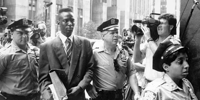 """This 1990 file photo provided by Sundance Selects shows accused rapist Yusef Salaam, second right, being escorted by police in New York in 1990. Salaam is the subject of the documentary, """"The Cent ..."""