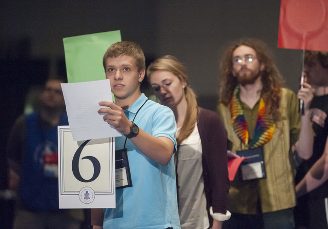 Young Adult Advisor Scott Overacker, of Roanoke, VA., front, adds his voice to the debate on whether the church should recognize same-sex marriage at the  221st General Assembly of the Presbyteria ...
