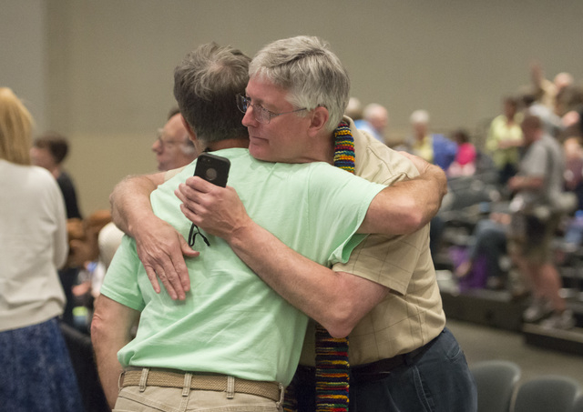 Gary Lyon, of Leechburg, PA, left, and Bill Samford, of Hawley, PA., celebrate after a vote allowing Presbyterian pastors discretion in marrying same-sex couples at the 221st General Assembly of t ...