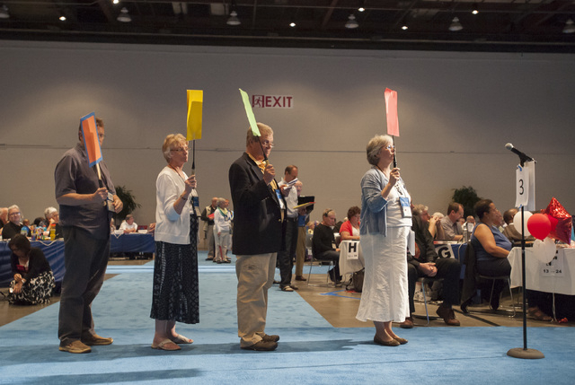 Commissioners and advisors wait in line to debate a vote on whether the church should recognize same-sex marriage at  the 221st General Assembly of the Presbyterian Church at Cobo Hall, in Detroit ...