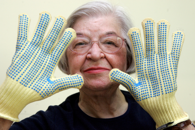 Stephanie Kwolek, 83, shown in this June 20, 2007 file photo taken in Brandywine Hundred, Del.,  she wears regular house gloves made with the Kevlar she invented. Her friend, Rita Vasta, told The  ...