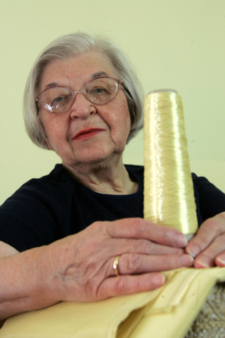 Stephanie Kwolek   poses for a photo holding with a spool of Kevlar, in this June 20 2007 file photo taken in Brandywine Hundred, Del. Her friend, Rita Vasta, told The Associated Press that Stepha ...