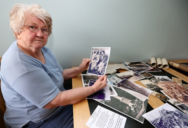 In this May 7, 2014, Dianne Nelson, 70, the daughter of World War I Pvt. Wilfred Smith, shows family photos during an interview at her home in Barnard Castle, England. Nelson said that her father  ...