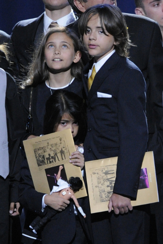 In this July 7, 2009 file photo, Paris Jackson, left, Prince Michael Jackson I and Prince Michael Jackson II on stage during the memorial service for Michael Jackson at the Staples Center in Los A ...