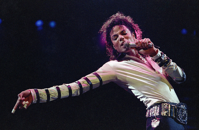 In this Feb. 24, 1988 file photo, Michael Jackson leans, points and sings, dances and struts during the opening performance of his 13-city U.S. tour, in Kansas City, Mo. Five years after Jackson's ...