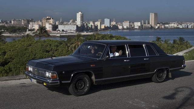 In this June 18, 2014 photo, taxi driver Moises Suarez navigates the Soviet-made limousine that he rents from the government in Havana, Cuba. Today the fleet of limos that were once part of Fidel  ...