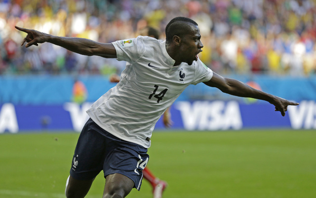 France's Blaise Matuidi celebrates after scoring his side's second goal during the group E World Cup soccer match between Switzerland and France at the Arena Fonte Nova in Salvador, Brazil, Friday ...