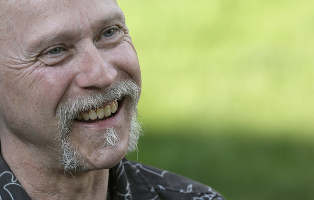 This Monday, June 16, 2014 photo shows Bill Palmisano smiling in North Canton, Ohio. A northern Georgia doctor running off-the-books adoptions in the 1950s and 60s placed infants with out-of-state ...