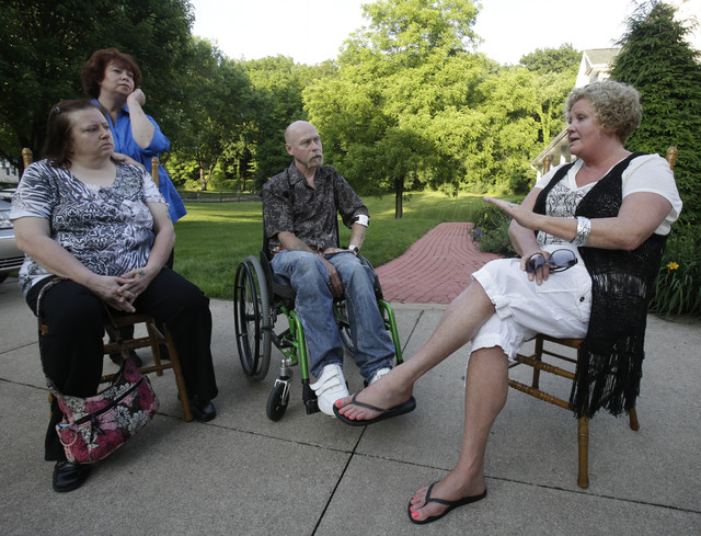 This Monday, June 16, 2014 photo shows Diane Conrad, left to right, Cyndy Stapleton, Bill Palmisano, and Melinda Elkins Dawson talking in North Canton, Ohio. A northern Georgia doctor running off- ...
