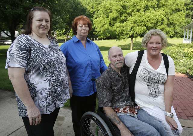 This Monday, June 16, 2014 photo shows Diane Conrad, left to right, Cyndy Stapleton, Bill Palmisano, and Melinda Elkins Dawson posing for a portrait in North Canton, Ohio. A northern Georgia docto ...