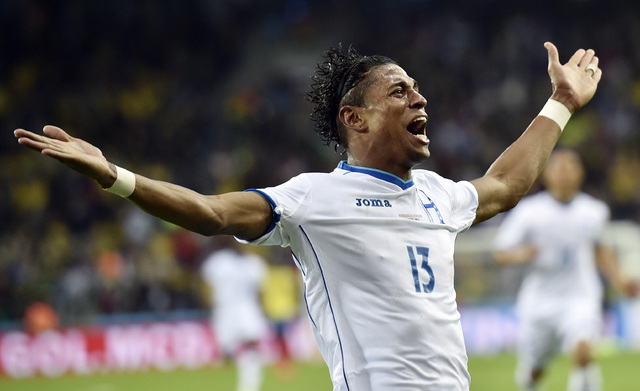 Honduras' Carlo Costly celebrates after scoring a goal during the group E World Cup soccer match between Honduras and Ecuador at the Arena da Baixada in Curitiba, Brazil, Friday, June 20, 2014.  ( ...