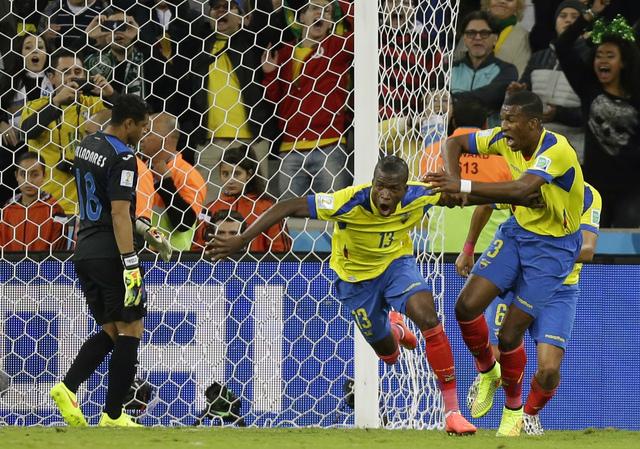 Ecuador's Enner Valencia, center, celebrates after scoring his side's second goal against Honduras' goalkeeper Noel Valladares during the group E World Cup soccer match between Honduras and Ecuado ...