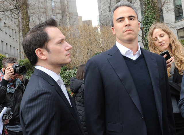 Michael Steinberg, second from right, exits Manhattan federal court with his defense attorney Barry Berke in New York. Lawyers have been given the green light to scan the social media sites of jur ...