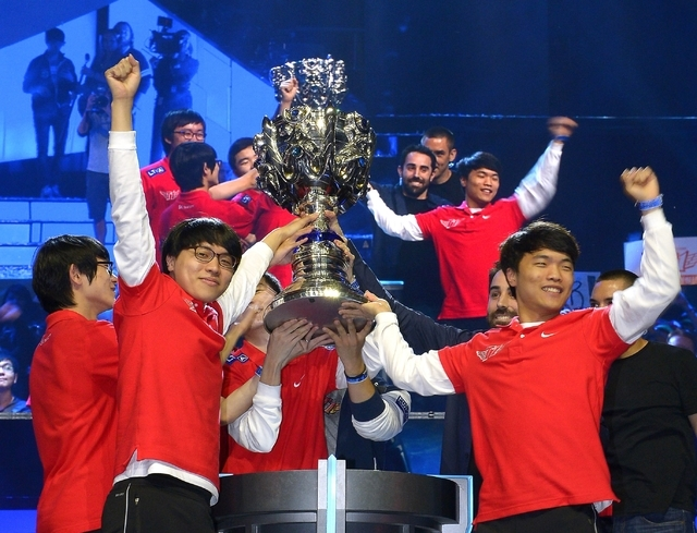 Members of South Korea's SK Telecom T1 team celebrate with their trophy after defeating China's Royal Club at the League of Legends Season 3 World Championship Final in Los Angeles. Robert Morris  ...