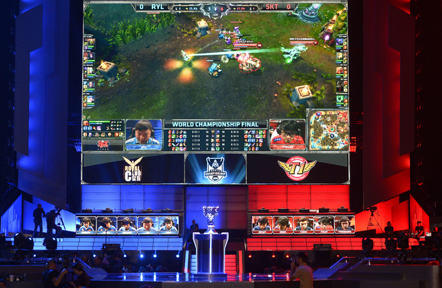 The teams of China's Royal Club, left, and South Korea's SK Telecom T1 compete at the League of Legends Season 3 World Championship Final in Los Angeles. Robert Morris University Illinois, a small ...