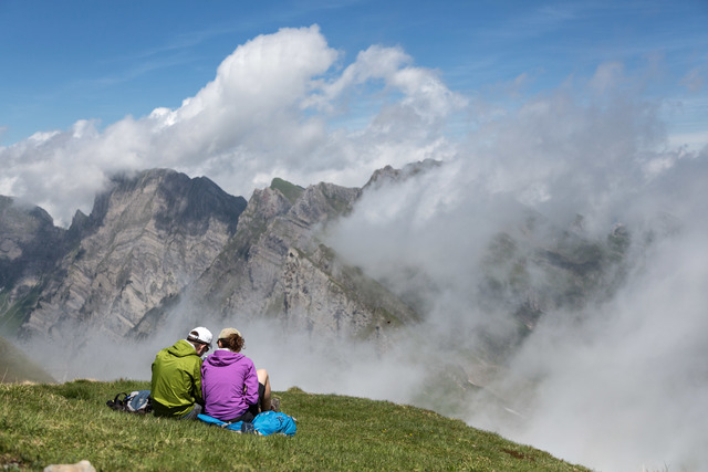 In this picture taken Saturday June 21, 2014, hikers take a rest  on the Alvier mountain  in the Swiss Alps near Truebbach , Switzerland. (AP Photo/Keystone, Arno Balzarini)
