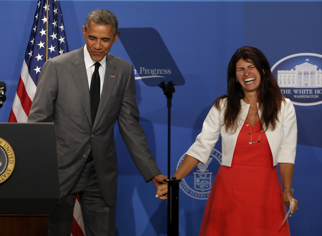 President Barack Obama is introduced by Lisa Rumain of Martinsville, N.J., at The White House Summit on Working Families, Monday, June 23, 2014, in Washington. The gathering, organized by the Whit ...