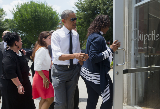 President Barack Obama walks with, from left, Shelby Ramirez, Lisa Rumain and Shirley Young to have lunch at a Chipotle Mexican Grill in Washington, Monday, June 23, 2014, before they attend the W ...