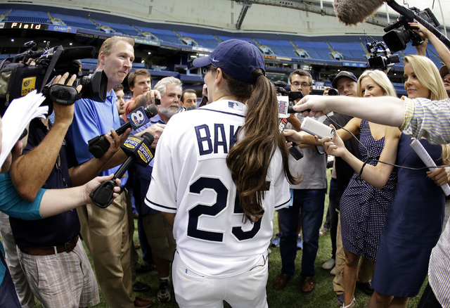 Chelsea Baker, a junior knuckleball pitcher on the Durant, Fla., High School boys baseball team, meets the media after throwing batting practice to members of the Tampa Bay Rays before an interlea ...