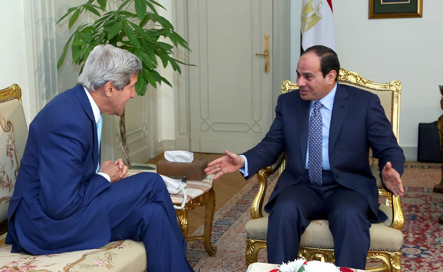 FILE - In this Sunday, June 22, 2014 file photo provided by Egypt's state news agency MENA, U.S. Secretary of State John Kerry, left, talks with Egypts President Abdel Fattah el-Sissi before a mee ...