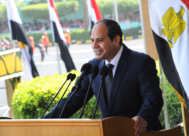 This image released by Egypt's official Middle East News Agency (MENA) shows President Abdel-Fattah el-Sissi speaking at a military graduation in Cairo, Tuesday, June 24, 2014. President el-Sissi  ...