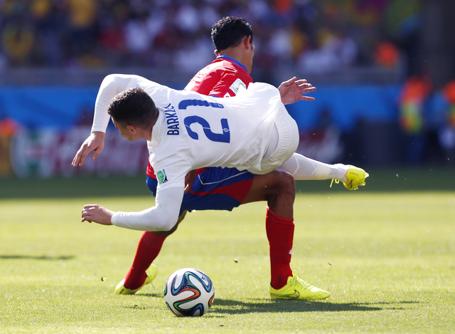 England's Ross Barkley, right, is fouled by Costa Rica's Giancarlo Gonzalez during the group D World Cup soccer match between Costa Rica and England at the Mineirao Stadium in Belo Horizonte, Braz ...