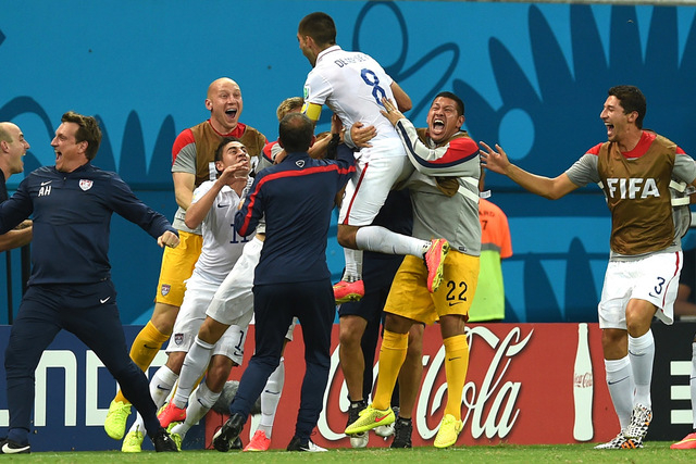United States' Clint Dempsey celebrates with his teammates after scoring his side's second goal during the group G World Cup soccer match between the USA and Portugal at the Arena da Amazonia in M ...