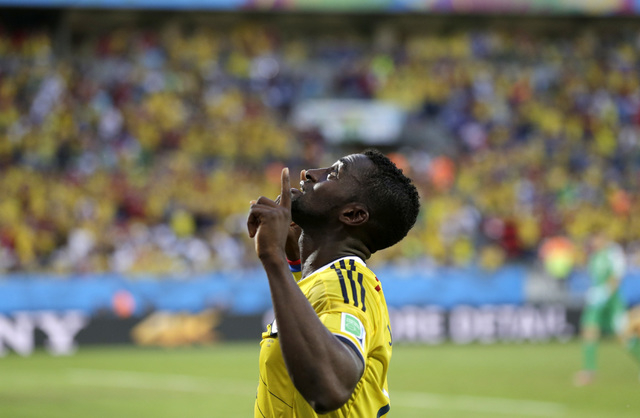 Colombia's Jackson Martinez celebrates after scoring during the group C World Cup soccer match between Japan and Colombia at the Arena Pantanal in Cuiaba, Brazil, Tuesday, June 24, 2014. (AP Photo ...