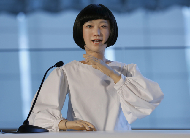 Android robot Kodomoroid speaks during a press event at the National Museum of Emerging Science and Innovation Miraikan in Tokyo Tuesday, June 24, 2014. The latest creations from Japanese android  ...