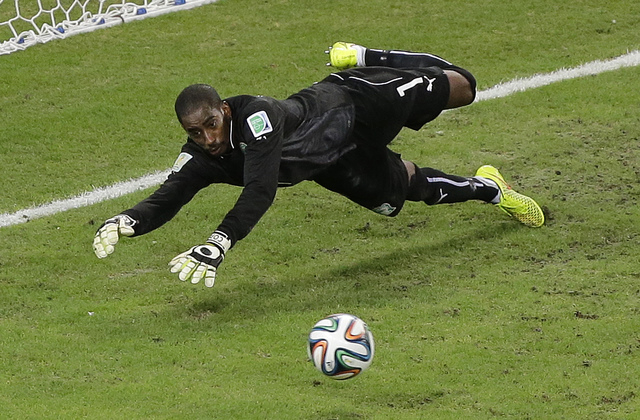 Ivory Coast's goalkeeper Boubacar Barry makes a diving save in the second half during the group C World Cup soccer match between Greece and Ivory Coast at the Arena Castelao in Fortaleza, Brazil,  ...
