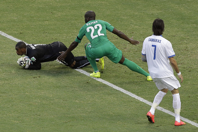 Ivory Coast's goalkeeper Boubacar Barry, left, makes a save as teammate Sol Bamba (22) and Greece's Giorgos Samaras look on during the group C World Cup soccer match between Greece and Ivory Coast ...