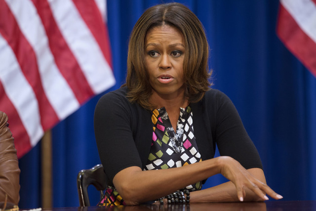 In this Tuesday, May 22, 2014 file photo, First lady Michelle Obama meets with issue experts about international girls' education in the Eisenhower Executive Office Building on the White House com ...