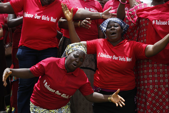 In this file photo taken on Tuesday, May 27, 2014, Women attend a prayer meeting calling on the government to rescue the kidnapped girls of the government secondary school in Chibok, in Abuja, Nig ...